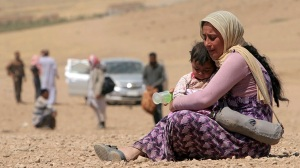 Real victims of western policy. and Isil violence: Christian woman and child made homeless.